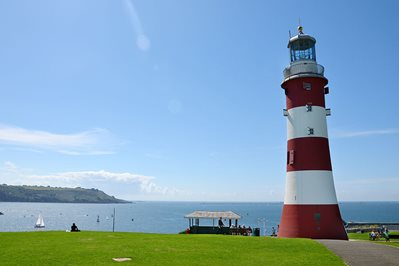 Red and white 'Smeatons tower' lighthouse on Plymouth hoe on a sunny day