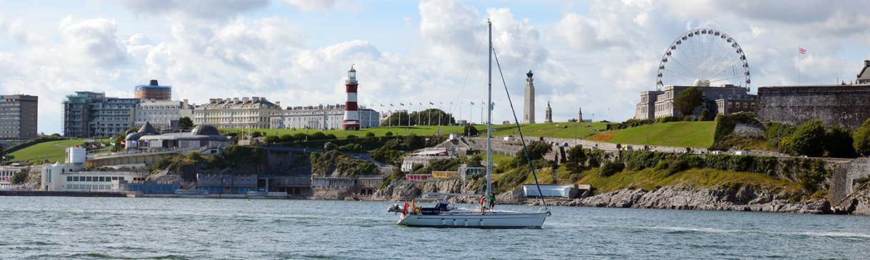 Plymouth Hoe on a sunny day with a Yacht in the foreground